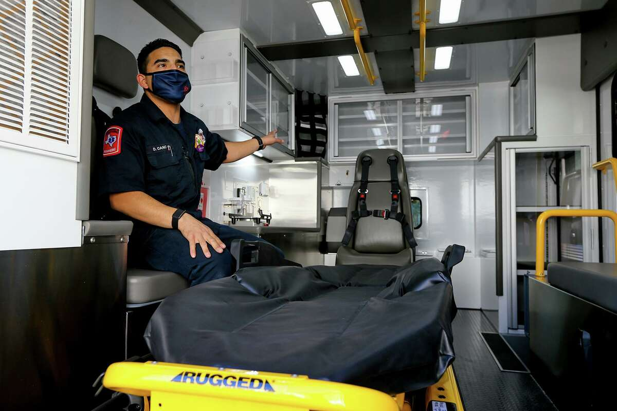 Converse Firefighter Paramedic Daniel Cano shows off the rear cabin of one of the three new Infectious Disease Response Units (IDRU) the city of Converse took possession of lst week. The new ambulances, funded entirely through the Coronavirus Aid Relief and Economic Security (CARES) Act, cost $275,000 each and feature UV lighting for decontamination, ultraviolet air purifiers, antimicrobial grab handles, and power-load stretchers to easily move patients in and out of the units.