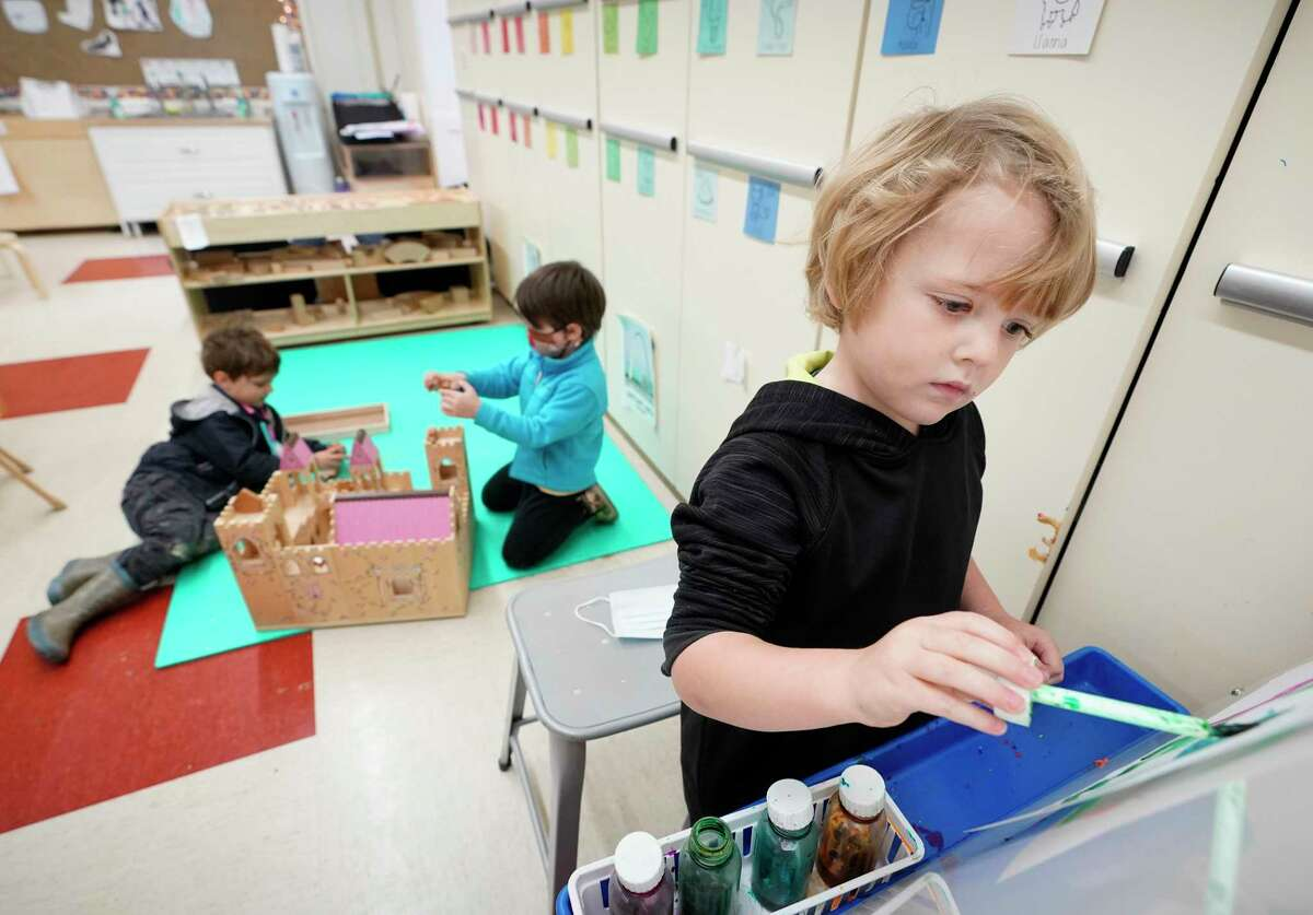 Henry Christenson, 4, paints during pre-kindergarten class at the Beehive Parent Child Center, 3756 University Blvd., Thursday, Dec. 17, 2020 in Houston. The cooperative is on the campus of West University Elementary School. Houston ISD is ending its partnership with several private early education organizations operating out of district campuses.