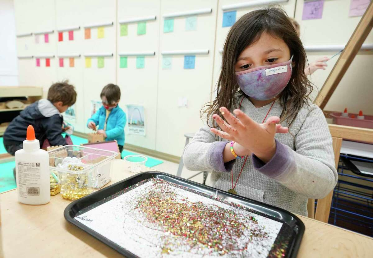 Reagan Spencer, 5, works with glitter during pre-kindergarten class at the Beehive Parent Child Center, 3756 University Blvd., Thursday, Dec. 17, 2020 in Houston. The cooperative is on the campus of West University Elementary School. Houston ISD is ending its partnership with several private early education organizations operating out of district campuses.