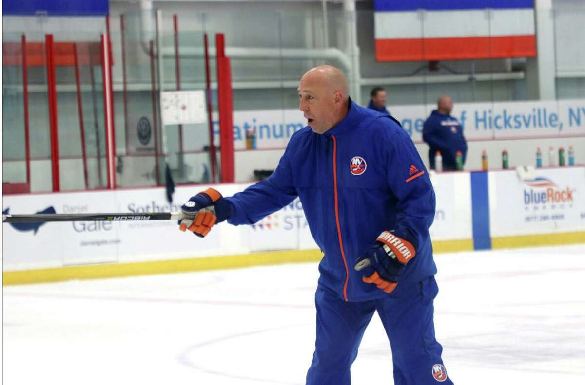 Bridgeport Sound Tigers coach Brent Thompson runs an Islanders minicamp practice at Northwell Health Ice Center in East Meadow, N.Y. in 2018.