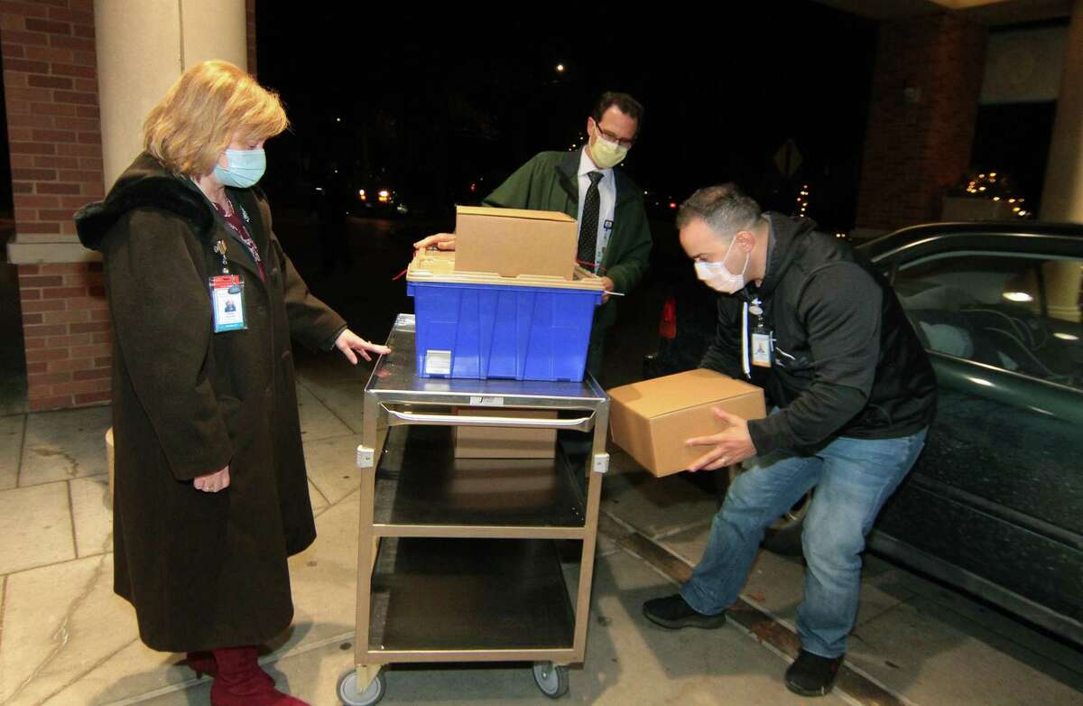Abdelmounaim Stitou with Lab Logisitics, delivers the first shipment of COVID-19 vaccine delivered from Yale New Haven Hospital at Greenwich Hospital in Greenwich, Conn., on Tuesday Dec. 15, 2020.
