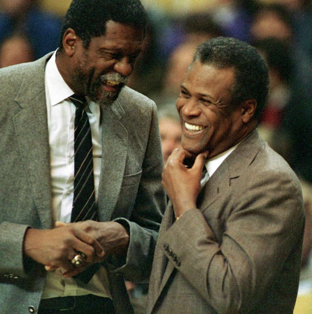 Sacramento Kings coach Bill Russell, left, and Celtics coach K.C. Jones, former Celtics teammates, meet before a 1988 game.