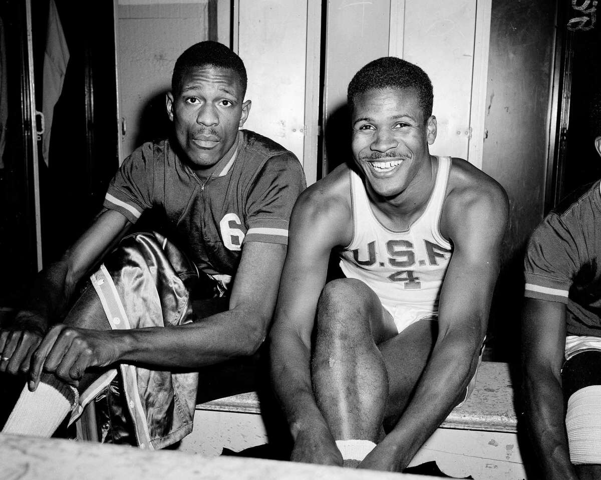 K.C. Jones, captain of the University of San Francisco Dons, right, is shown with teammate Bill Russell in a 1956 file photo.
