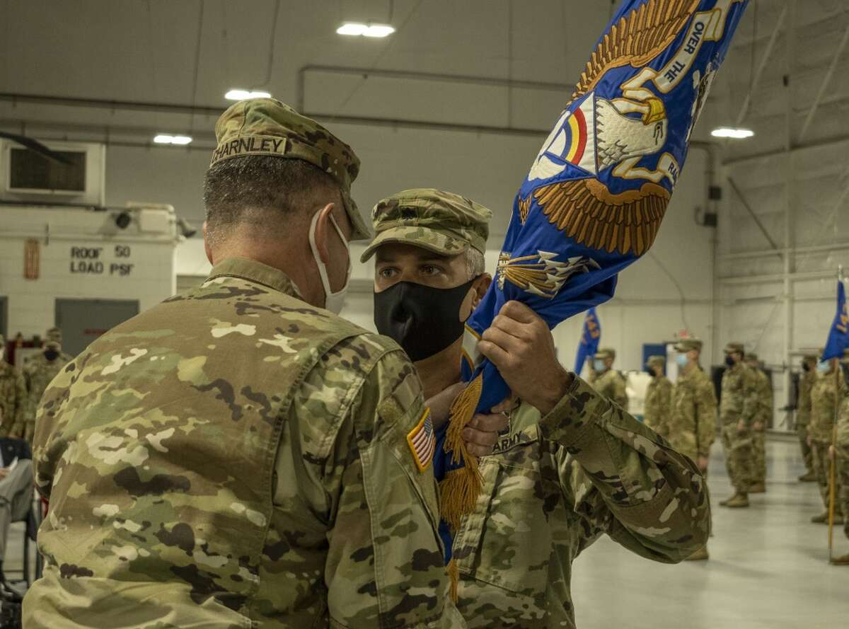 Sgt. Matthew Gunter / New York Army National Guard Lt. Col. Matthias Greene receives the 3rd Battalion, 142nd Assault Helicopter Regiment flag from Col. Michael Charnley, 42nd Combat Aviation Battalion commander, during a change of command ceremony in Ronkonkoma.