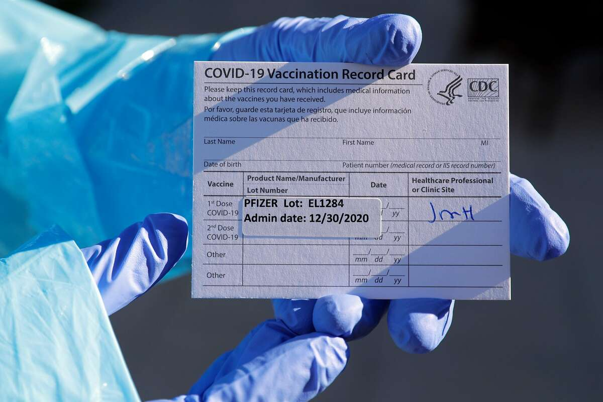 Dr. Kishore Nath holds a vaccination card provided to residents who have been given the Pfizer COVID-19 vaccine at Viamonte, a retirement community in Walnut Creek, Calif., on Wednesday, December 30, 2020. Medical personnel from John Muir Medical Center administered the vaccinations to residents.