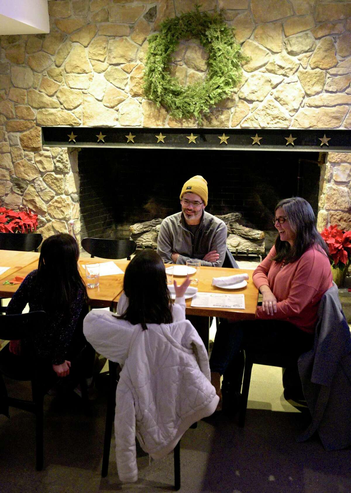 The Kakos family of Danbury, Holland, 6, left, Maryn, 8, Gary and Alaina are at Good Old Days Pizzeria and Cocktail Den, in the lower level of Marygold's on Main, on its opening night, Wednesday, December 30, 2020, in Newtown. Conn. they said they follow Matt, pizza guy Matteo Stanz, on Instagram and go wherever he's cooking.