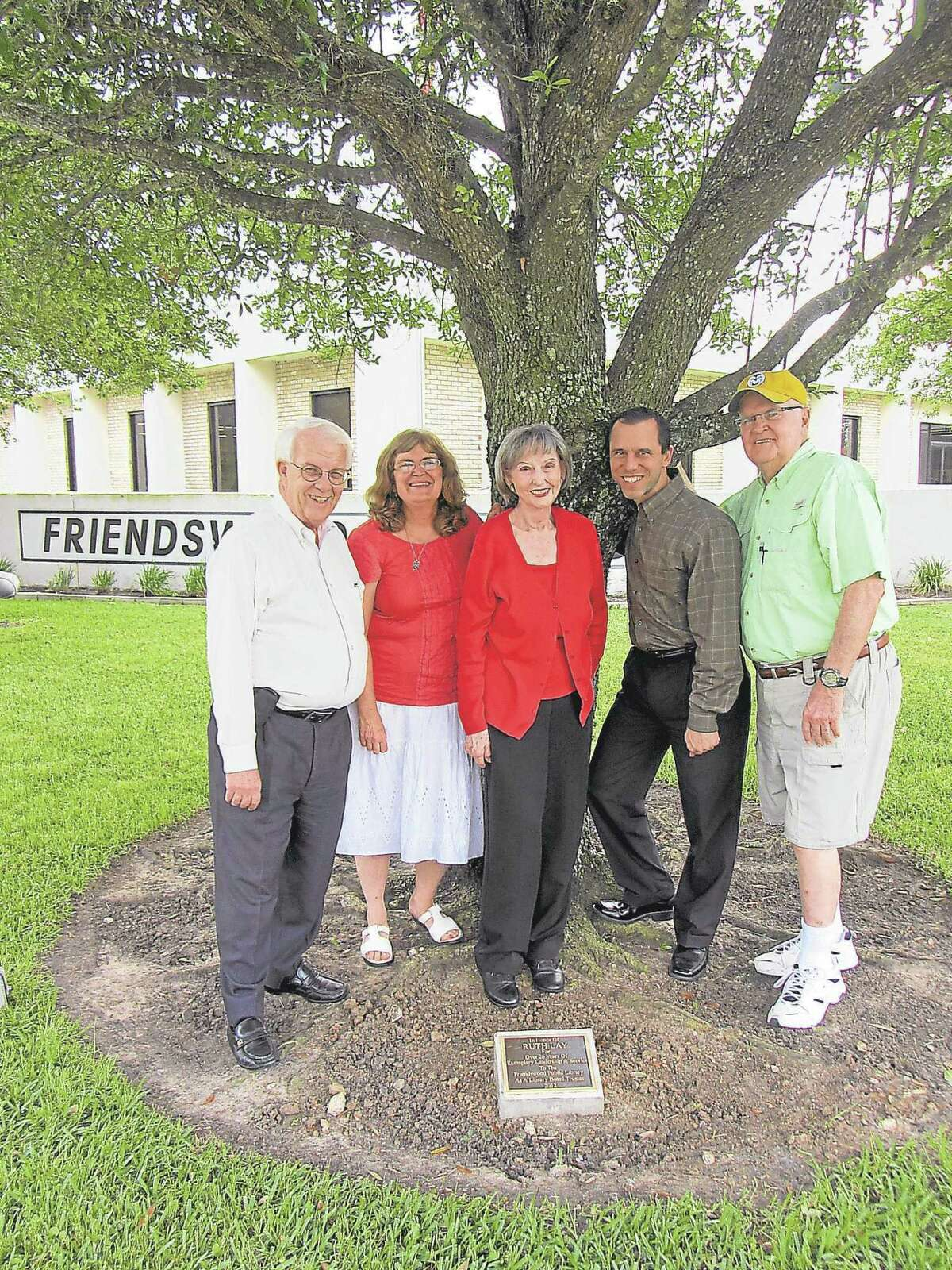 Ted Thomas Sr., right, joins a group in 2013 honoring Ruth Lay for her service to the Friendswood Public Library on the library board. Also pictured are Mike Czarowitz, left, Mary Perroni, Lay and Billy Enochs.