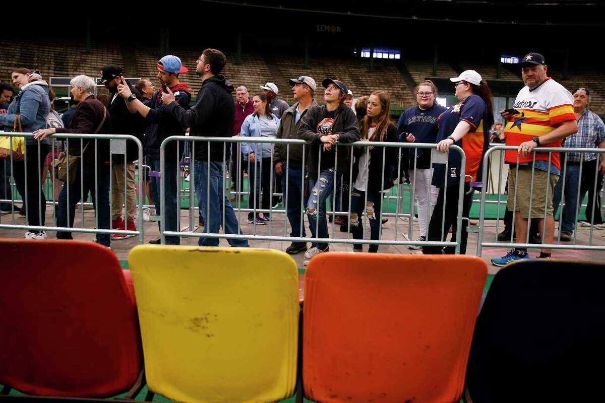 People look at Astrodome memorabilia, including the stadium seats, during Domecoming, an event celebrating the 53rd anniversary of the Astrodome, Monday, April 9, 2018 in Houston. (Michael Ciaglo / Houston Chronicle)