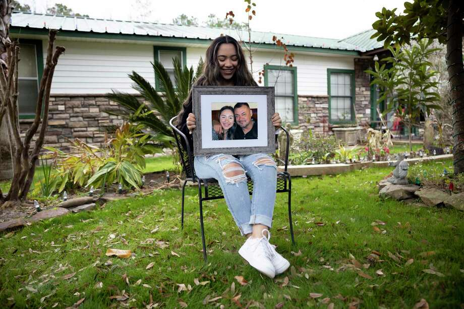 Kiara Cardenas poses for a portrait as she holds a photo of her and her father, Julio, outside her home, Wednesday, Dec. 30, 2020, in Willis. Julio Cardenas, 43, was shot to death in an an early October parking lot shooting in Conroe. Photo: Gustavo Huerta, Houston Chronicle / Staff Photographer / 2020 © Houston Chronicle