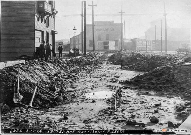 Many streets in the industrial South of Market neighborhood were not yet paved in 1921. This photo shows a muddy 13th and Folsom at the time. Photo: OpenSFHistory