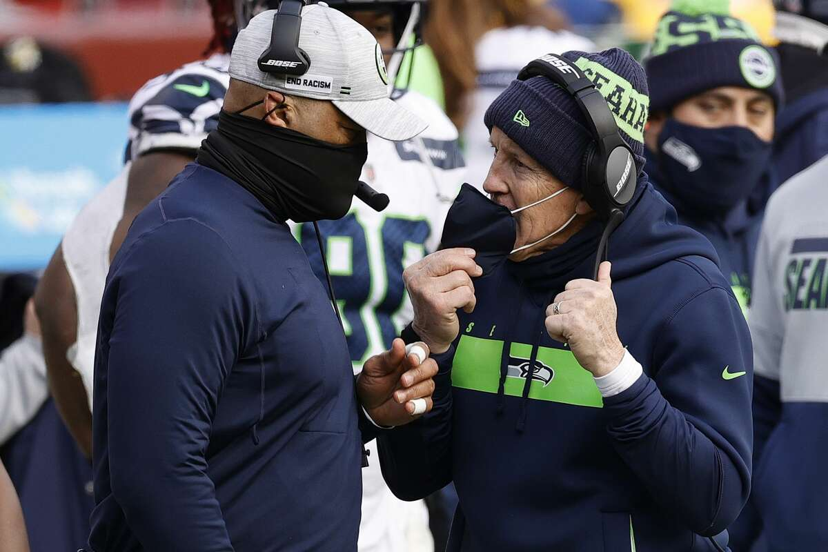 LANDOVER, MARYLAND - DECEMBER 20: Head coach Pete Carroll of the Seattle Seahawks speaks with defensive cooridinator Ken Norton Jr. at FedExField on December 20, 2020 in Landover, Maryland. (Photo by Tim Nwachukwu/Getty Images)