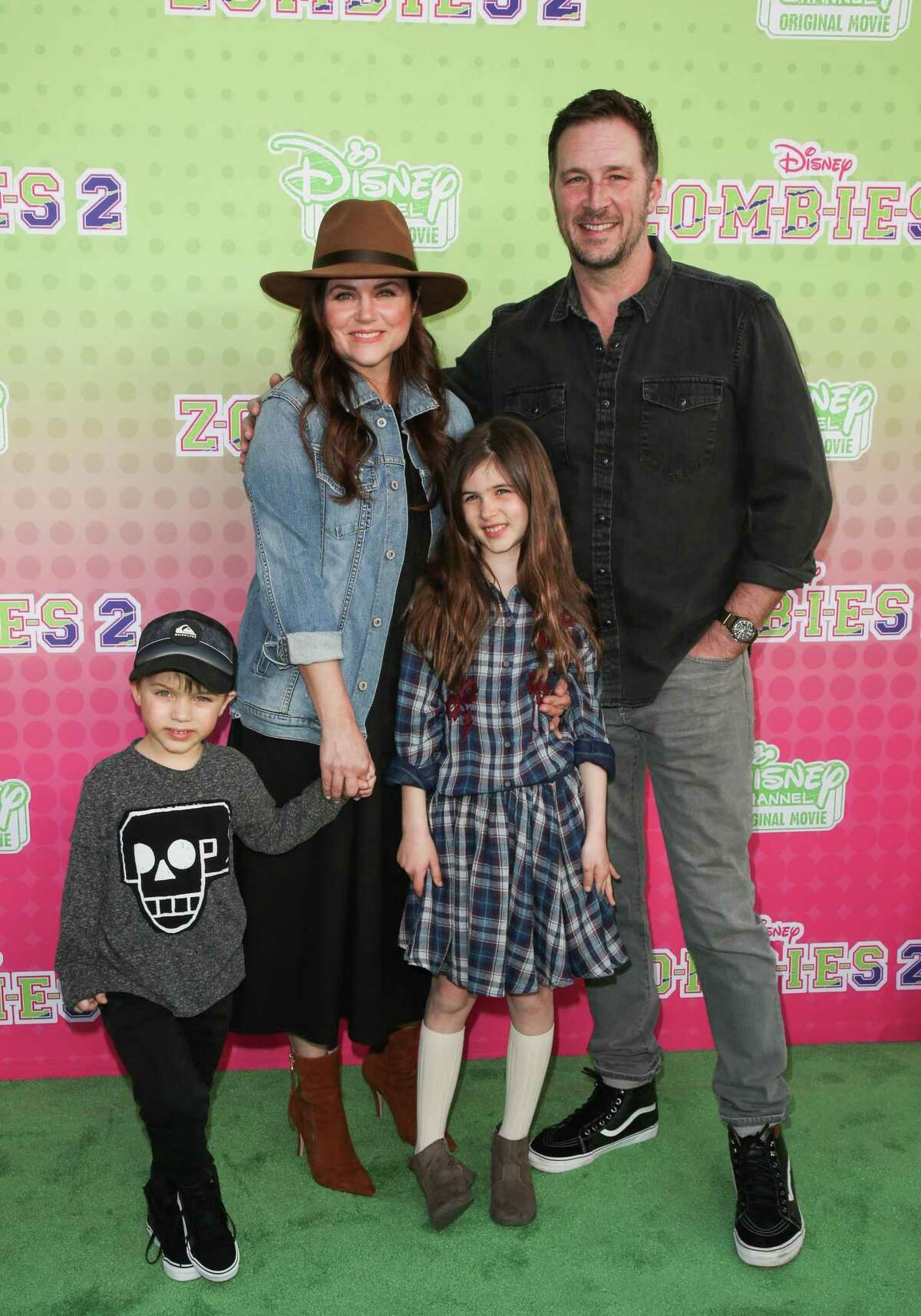 Tiffani Thiessen and husband Brady Smith with their kids attend the screening of the Disney Channel original movie