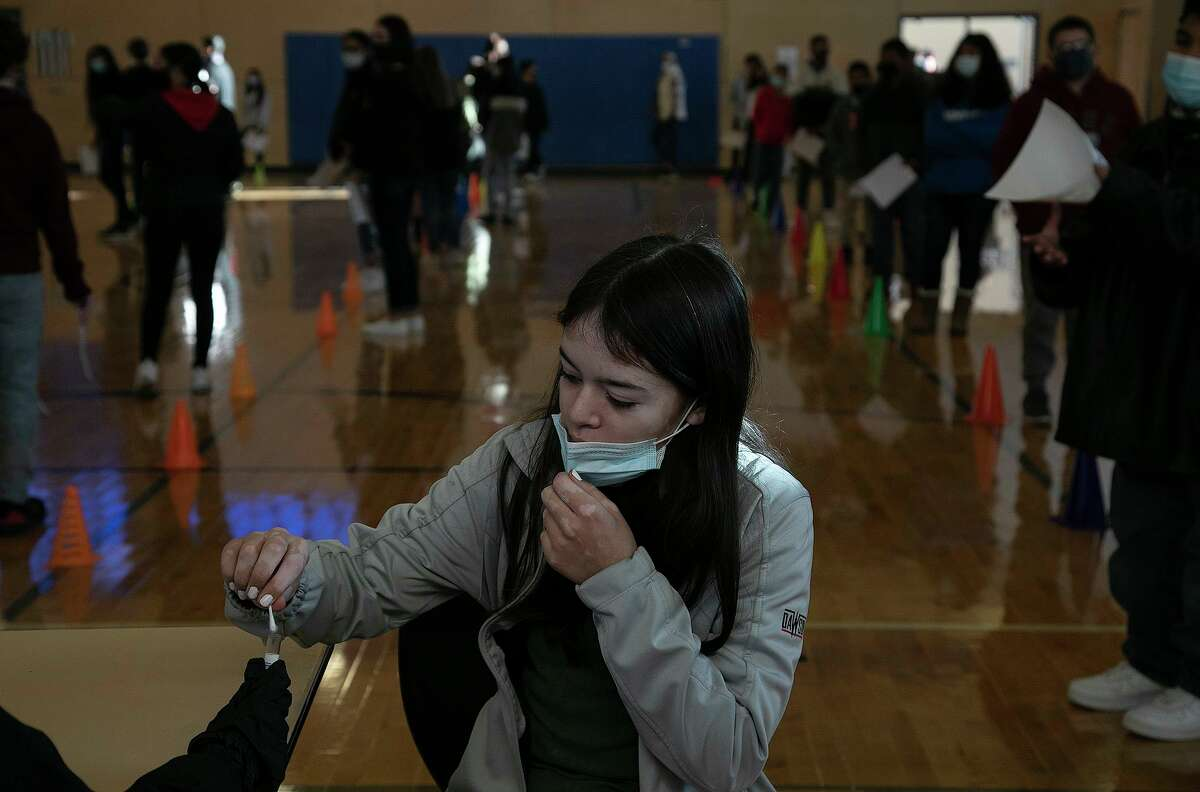 Students swab their noses for their weekly COVID-19 test by Community Labs at Somerset Junior High School in Von Ormy on Dec. 7, 2020.