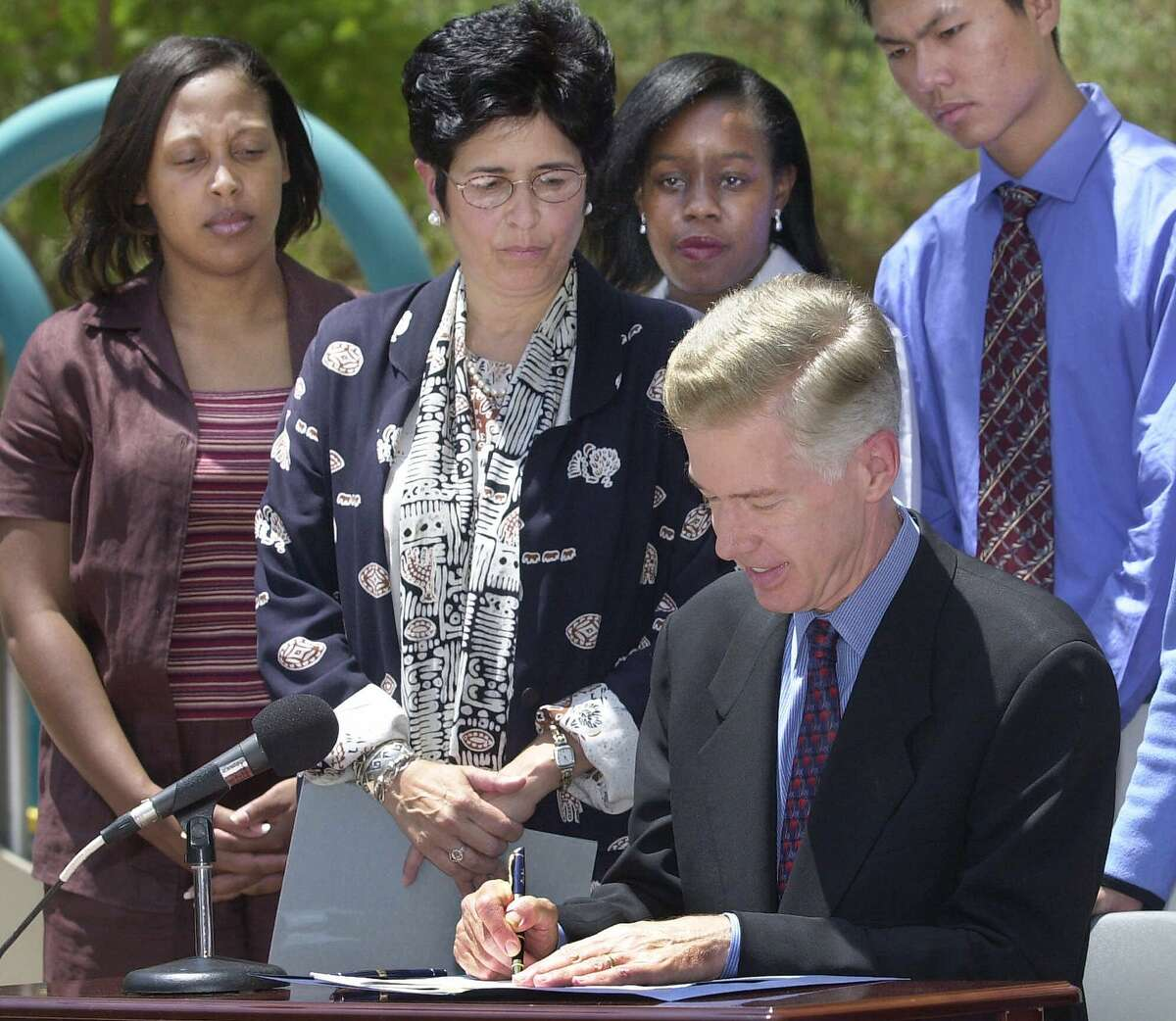 Rita Saenz (second from left) ran the California Department of Social Services under Gov. Gray Davis. She is returning to government to run the troubled Employment Development Department.