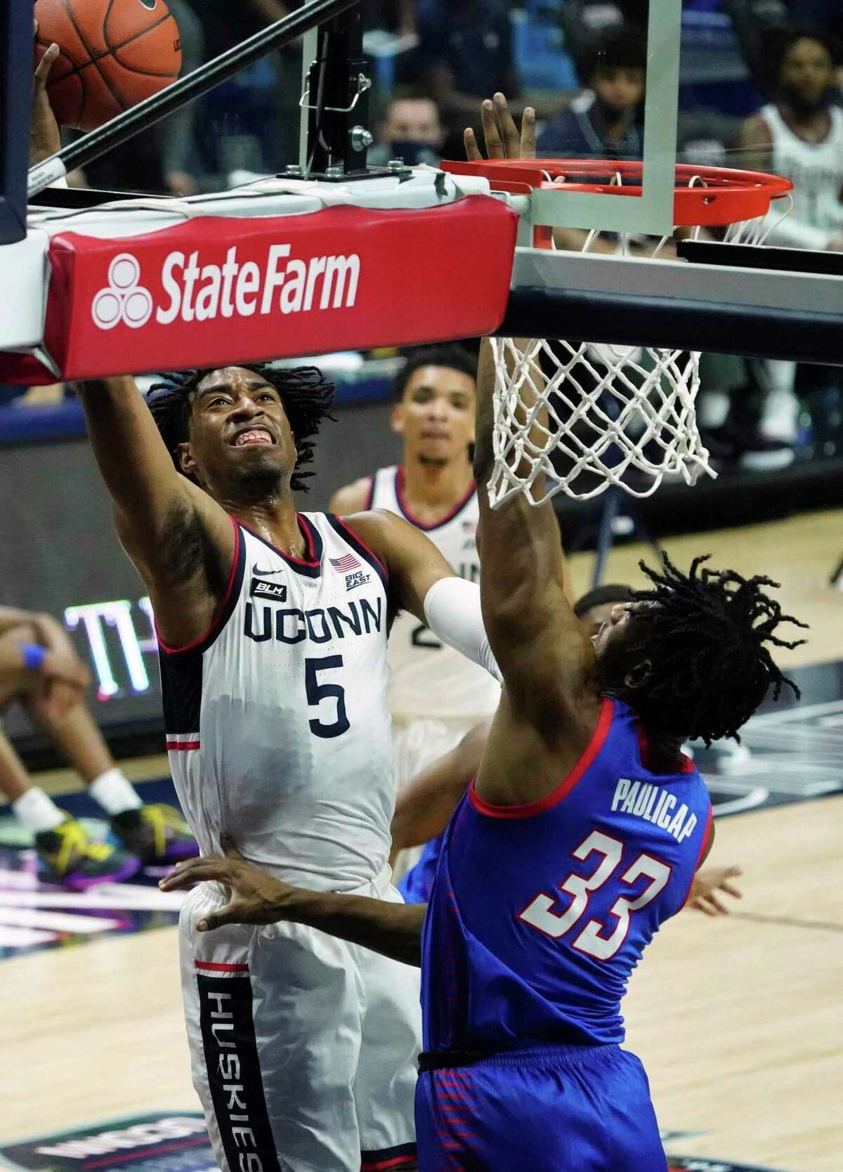 UConn forward Isaiah Whaley (5) shoots against DePaul forward Pauly Paulicap during the first half on Wednesday in Storrs.