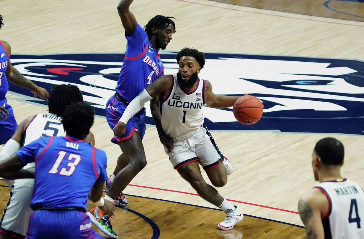 UConn guard R.J. Cole (1) drives the ball against DePaul guard Javon Freeman-Liberty during the first half on Wednesday in Storrs.