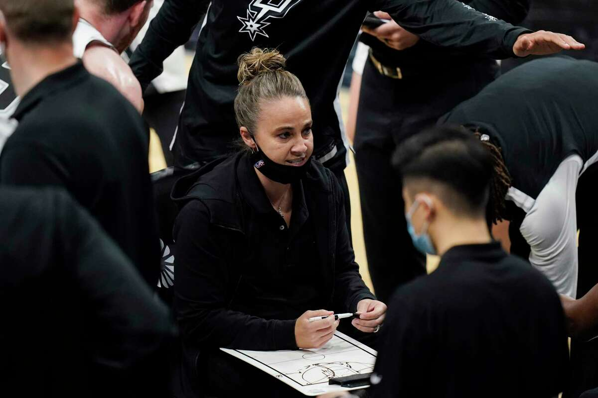 San Antonio Spurs assistant coach Becky Hammon calls a play during a timeout in the second half of the team's NBA basketball game against the Los Angeles Lakers in San Antonio, Wednesday, Dec. 30, 2020. (AP Photo/Eric Gay)