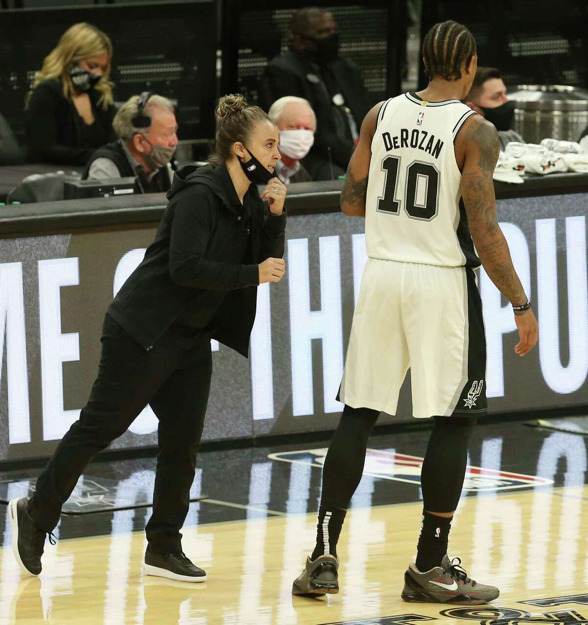 Assistant coach Becky Hammon talks to DeMar DeRozan (10) as she takes over coaching duties after Gregg Popovich was ejected in the first half of the game against the Los Angeles Lakers at the AT&T Center on Wednesday, Dec. 30, 2020.