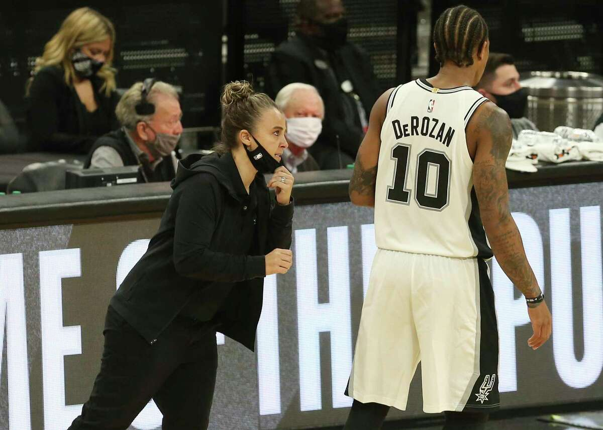 Becky Hammon issues instructions to DeMar DeRozan after taking over head coaching duties when Gregg Popovich was ejected during the first half Wednesday.