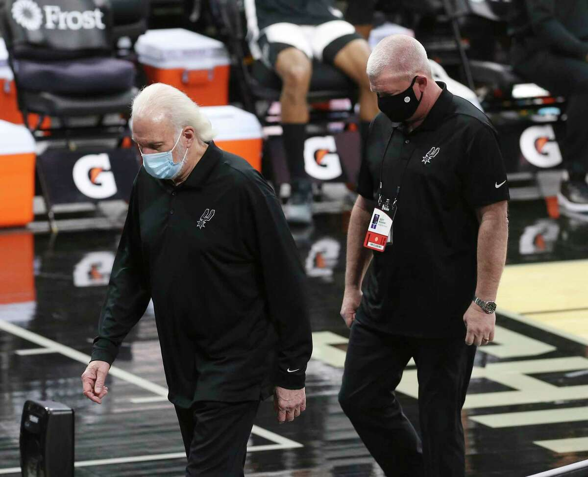 Spurs' coach Gregg Popovich walks off the court after getting ejected by game official during the game against the Los Angeles Lakers at the AT&T Center on Wednesday, Dec. 30, 2020.