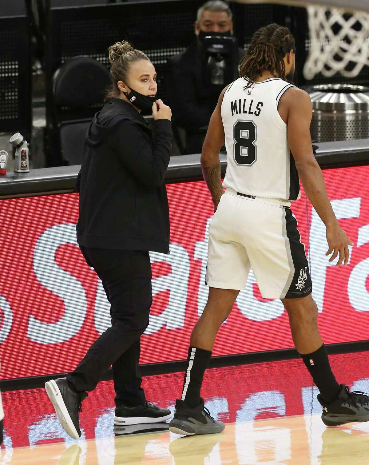 Assistant coach Becky Hammon (center) takes over the coaching duties after Gregg Popovich gets ejected from the game against the Los Angeles Lakers at the AT&T Center on Wednesday, Dec. 30, 2020.