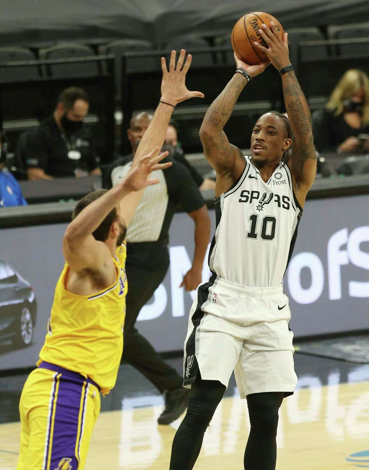 Spurs' DeMar DeRozan (10) shoots over Los Angeles Lakers' Marc Gasol (14) during their game at the AT&T Center on Wednesday, Dec. 30, 2020.