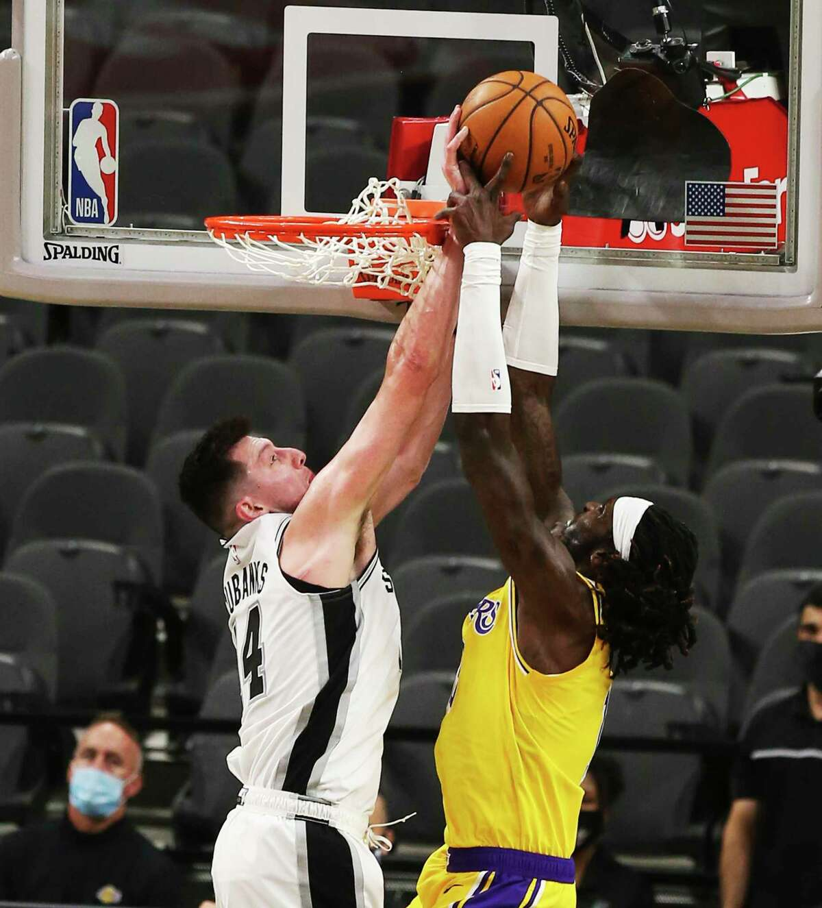 Spurs' Drew Eubanks (14) blocks a shot against Los Angeles Lakers' Montrezl Harrell (15) during their game at the AT&T Center on Wednesday, Dec. 30, 2020.