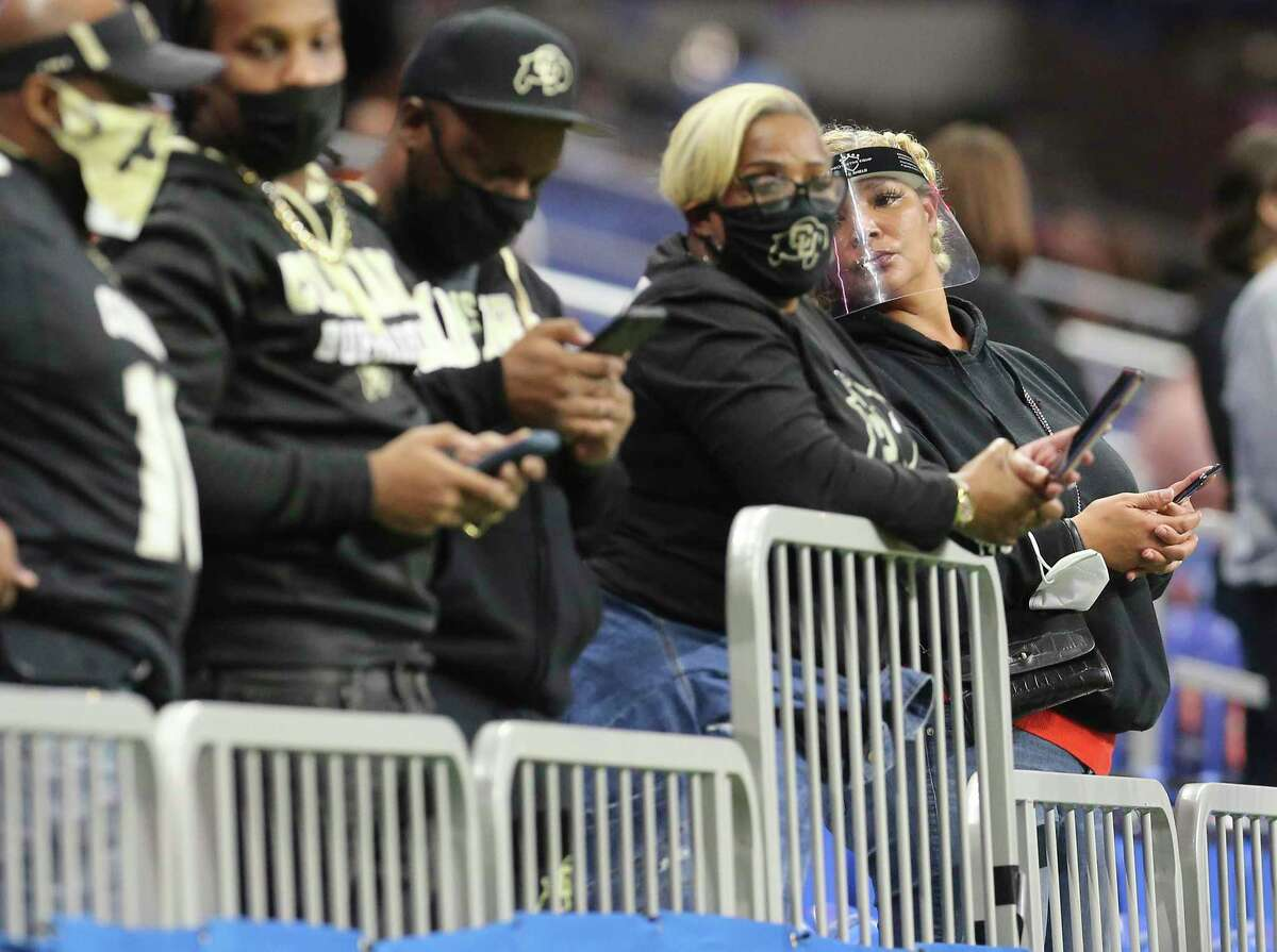 Most fans wore masks or face shields at the 2020 Valero Alamo Bowl at the Alamodome on Tuesday.
