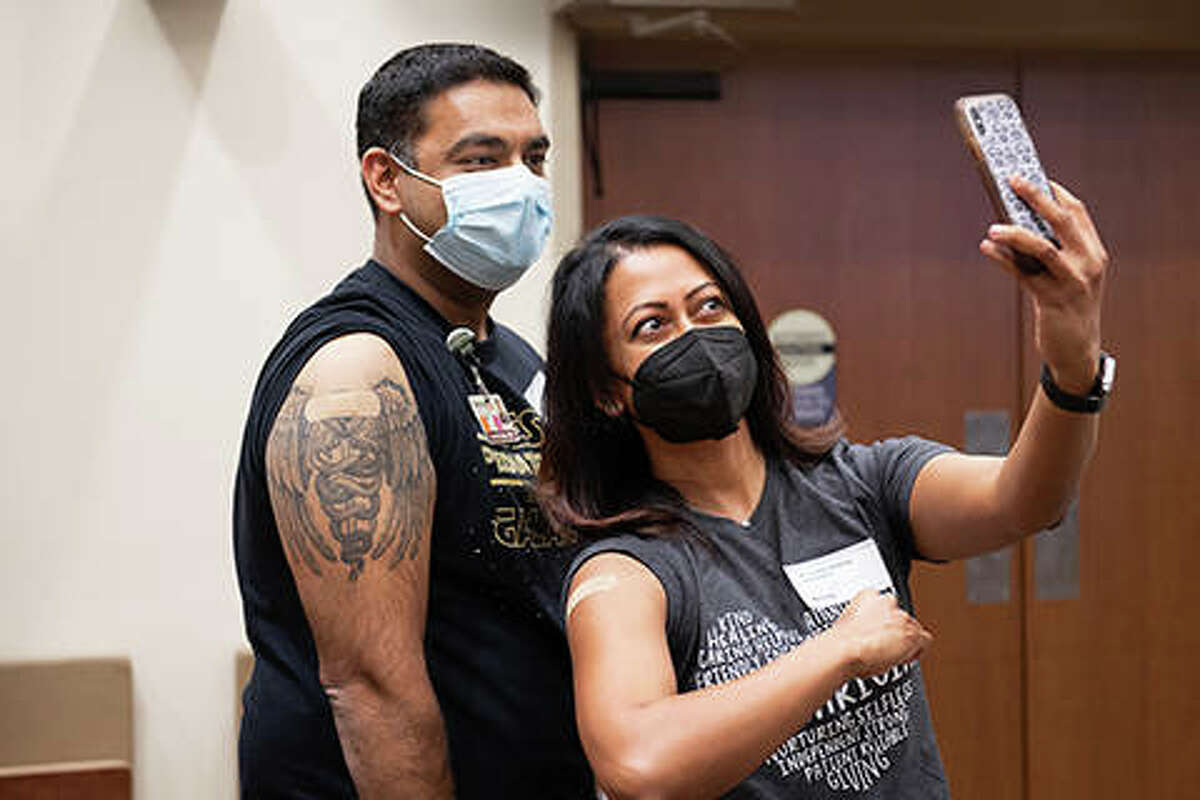Doctors Ashish and Teena John, husband and wife pediatricians at Memorial Physician Services-Koke Mill, pose for a selfie after receiving their COVID-19 vaccination. They are among more than 3,000 throughout Memorial Health System who have received their first shots.