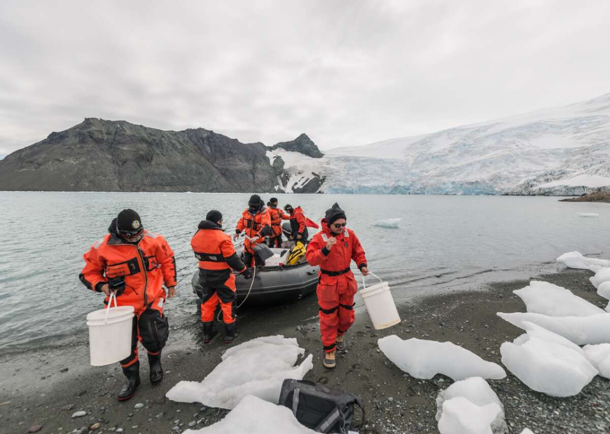 """Comandante Ferraz Station in Antarctica ready for 2020 inauguration A team of researchers and Brazilian Navy sailors arrives at the beach of Dobrowolsky Glacier to collect ice and soil samples, on Jan. 4 in King George Island, Antarctica prior to the inauguration of Brazil's Comandante Ferraz Station. The $100 million station, which opened in mid-January, is a """"first-class"""" replacement of one that burned down in 2012."""