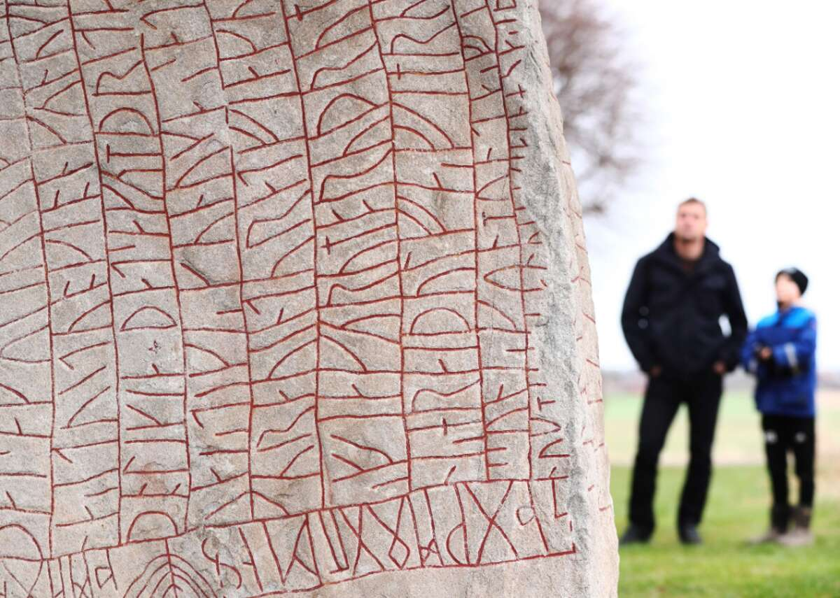 Viking-era runestone warns of climate crisis A father and a son look at the Viking-era Rök runestone near the Lake Vattern and the town of Odeshog, in Ostergotland, Sweden, on Jan. 9. Raised in the ninth century, the Rök stone bears the longest runic inscription in the world, which scholars believe to be a grieving father's eulogy for his recently deceased son and a warning about an impending period of extreme cold.