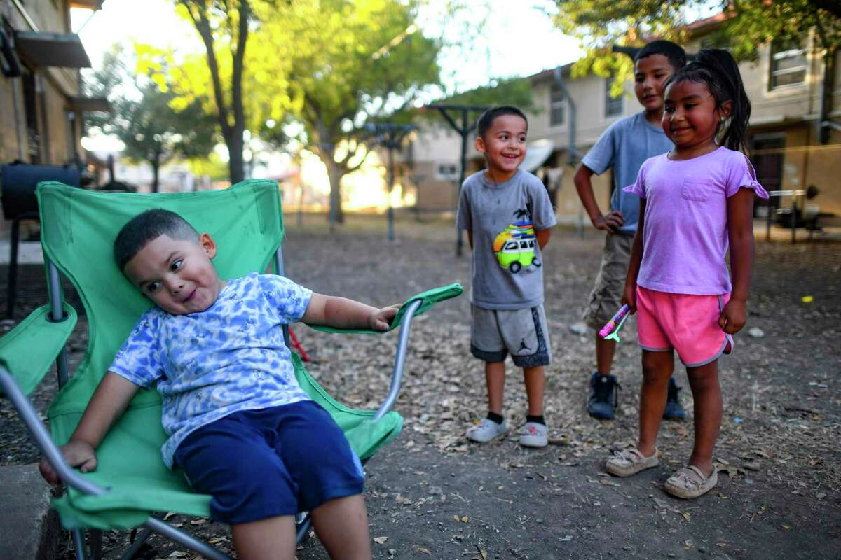 Children play at Alazan Courts last month. A reader implores the San Antonio Housing Authority to consider the needs of residents struggling to shelter their families.