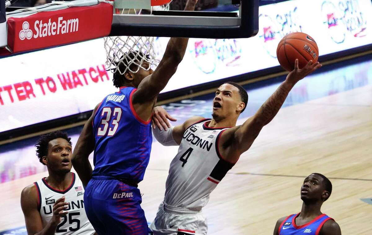 UConn guard Tyrese Martin shoots against DePaul forward Pauly Paulicap during Wednesday's game. Martin, a transfer from Rhode Island, contributed 22 points and 10 rebounds.
