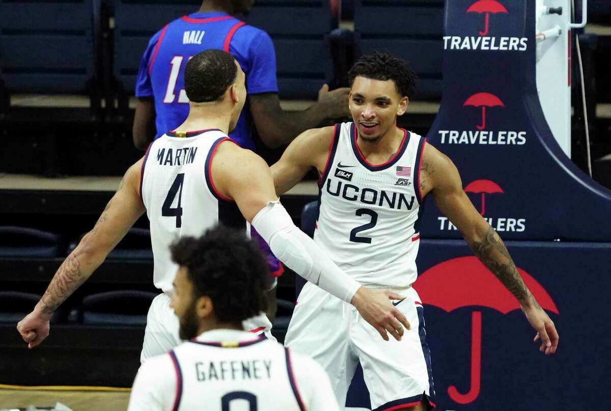 UConn guard James Bouknight (2) celebrates with guard Tyrese Martin (4) after making a basket against DePaul during Wednesday's game.