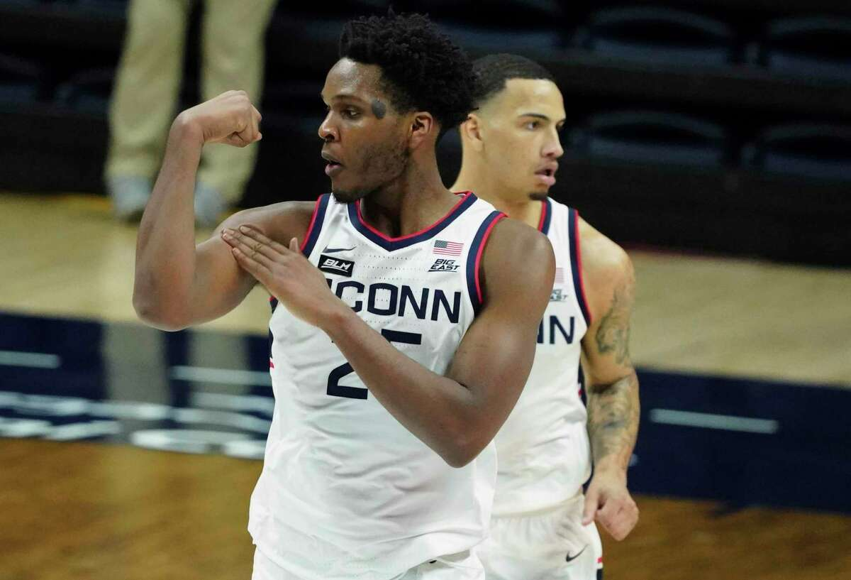 UConn forward Josh Carlton reacts after making a basket against DePaul on Wednesday.