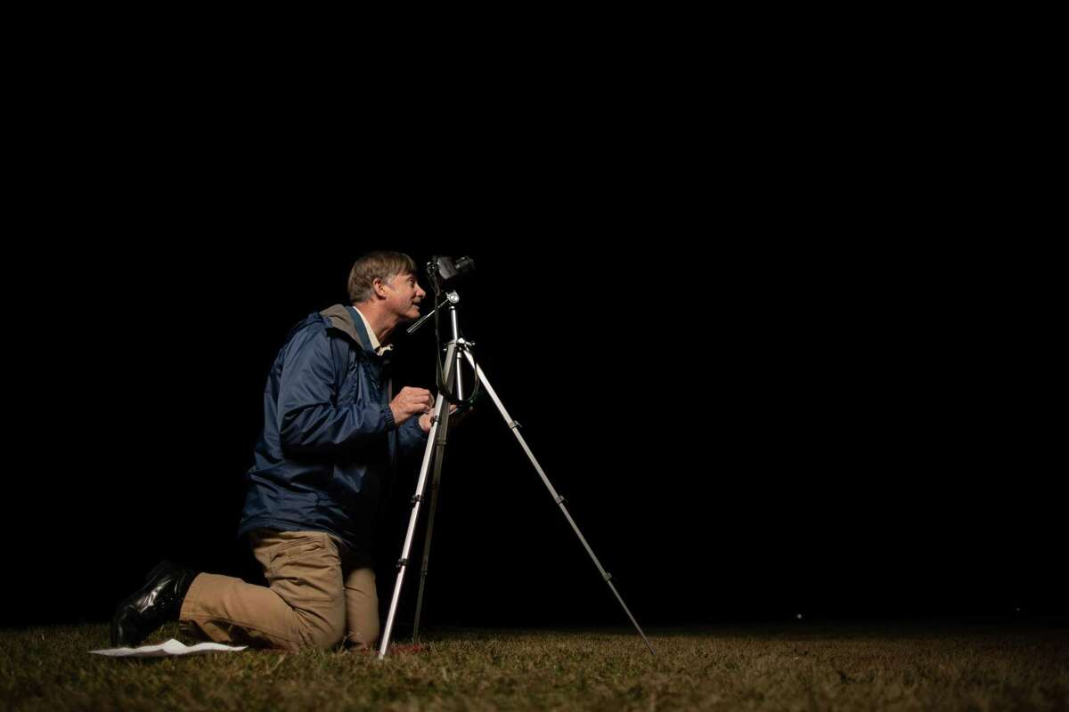 Charles Phillips prepares his Nikon D200 to photograph a classified satellite he wishes to track, Wednesday, Dec. 9, 2020, in Clear Lake.