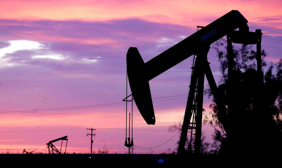 An oil pumpjack works in the field in Penwell, Texas. Forty-six exploration and production companies and 61 oil-field service companies filed for Chapter 11 bankruptcy last year, according to Haynes and Boone, a Dallas law firm tracking bankruptcies. The 107 oil and gas bankruptcies in 2020 were the most since 142 bankruptcies were filed during the last oil bust in 2016.