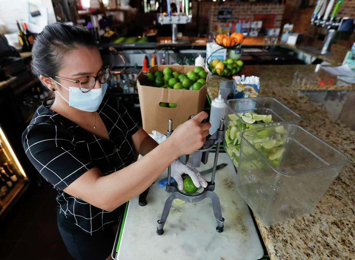 """Bartender Meagan Oliver cuts limes at Fajita Jack's Tex-Mex Grill and Cantina, Saturday, June 27, 2020, in Montgomery. Gov. Greg Abbott order restaurants to reduce capacity from 75% to 50% beginning Monday in response to the growing number of coronavirus cases. Gov. Greg Abbott announced Thursday, Sept. 17, that most of Texas will be able to loosen some coronavirus restrictions, allowing many businesses - including restaurants - to increase their capacity to 75%, as soon as Monday, Sept. 21. At the same time, Abbott said the state was not yet ready to reopen bars, saying they are """"nationally recognized as COVID-spreading locations."""" He stressed, though, that the state is looking for ways to let bars reopen safely."""