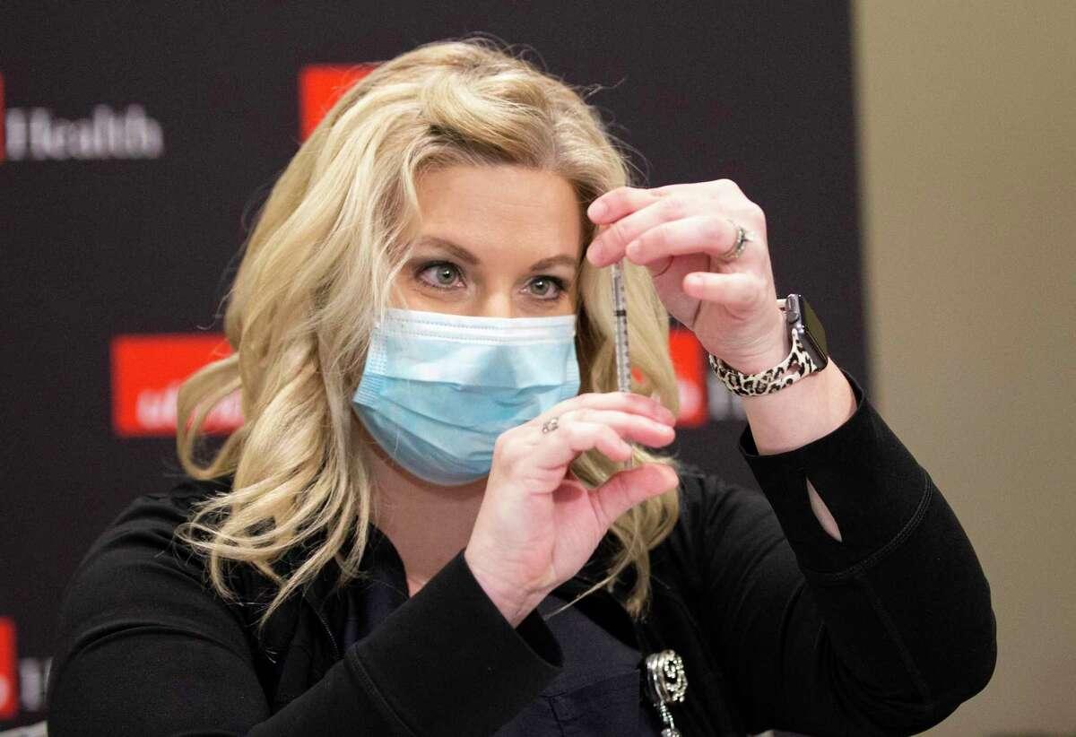 UTMB Galveston Registered Nurse Michelle Garza prepares a shot of the Pfizer Covid-19 vaccine Tuesday, Dec. 15, 2020, in Galveston.