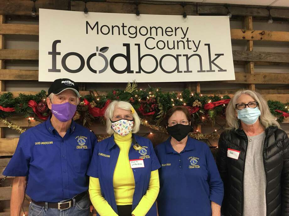 Members of Lake Conroe Centennial Lions Club volunteered to sort canned goods and produce at the Montgomery County Food Bank Distribution Center. Pictured here, left to right are Dave Underdown, Marie Underdown, Dian Dodd and Vicki Migues. Photo: Courtesy Photo