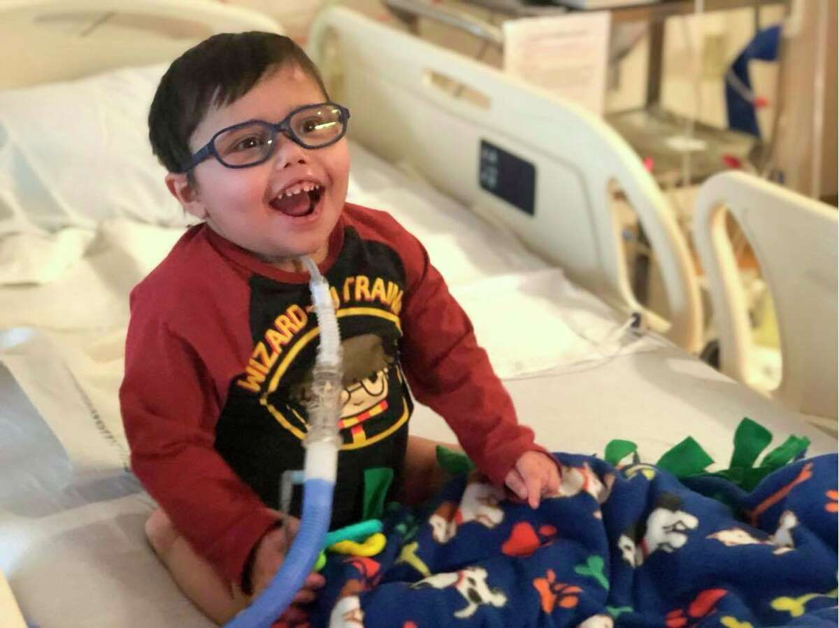Then-4-year-old Anderson Moreno, of Big Rapids, gives the camera a big smile as he sits in his bed at C.S. Mott Children's Hospital in Ann Arbor in March. Anderson is currently in need of a live kidney donor. (Courtesy photo)