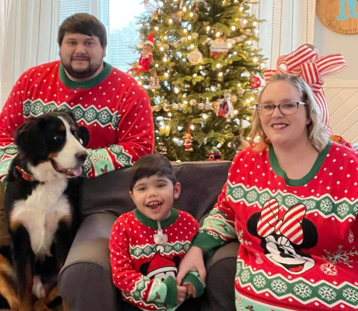 (From left) Andrew, Anderson and Alicia Moreno share big smiles in front of their Christmas tree at their Big Rapids home during the holidays this year. The Moreno family are currently in search of a live kidney donor for 5-year-old Anderson.