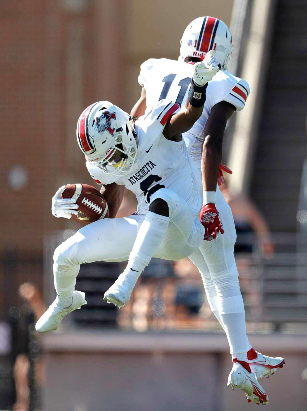 Atascocita running back Tyras Winfield (6) reacts with wide receiver Chase Sowell (11) after scoring a 31-yard touchdown during the second quarter of a District 21-6A high school football game at Turner Stadium, Saturday, Oct. 31, 2020, in Humble.