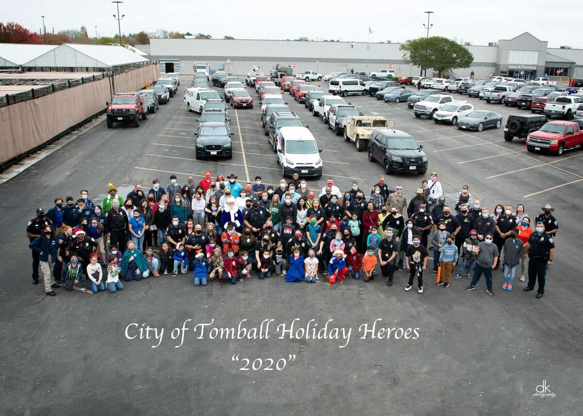 Tomball police officers, firefighters and public works employees come together to provide gifts to families in need for Christmas as part of their first Holiday Heroes event.