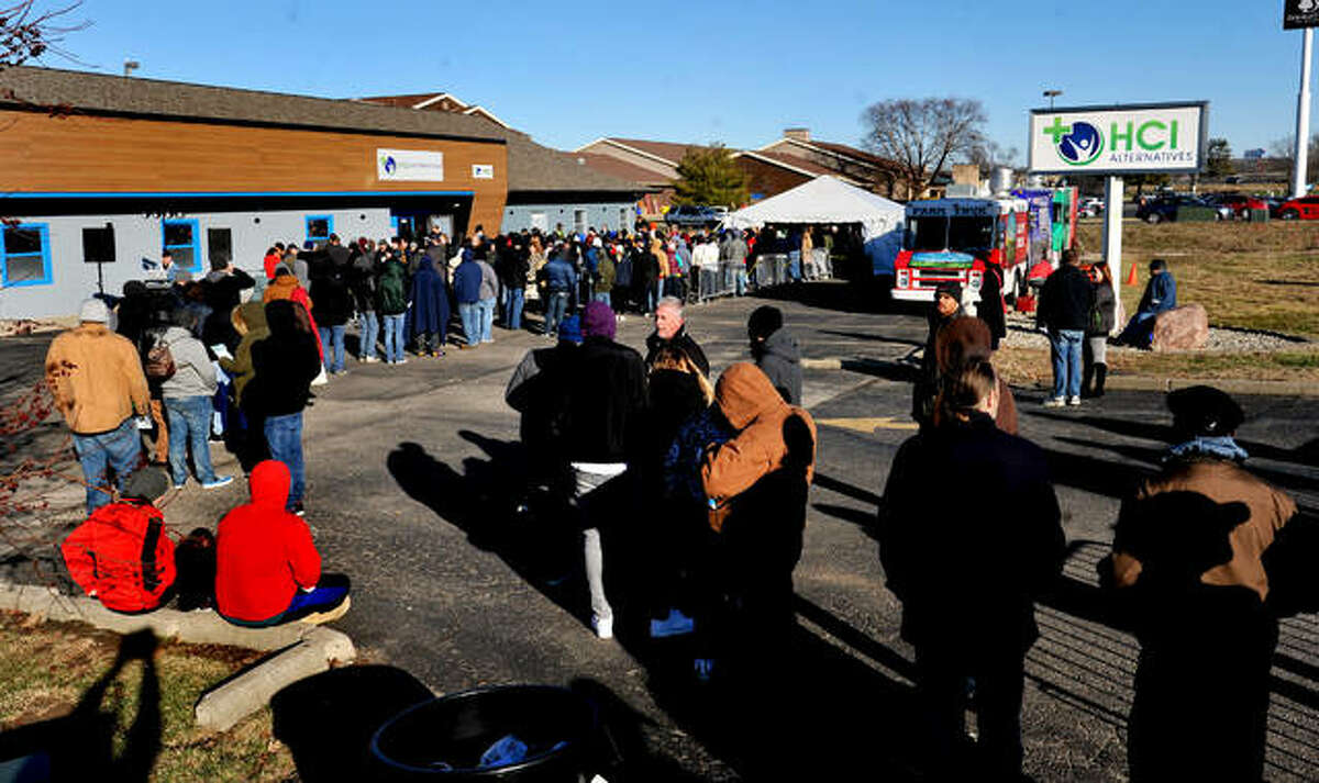 Customer line up in front of the HCI building in Collinsville on News Year's Day to purchase cannabis legally.