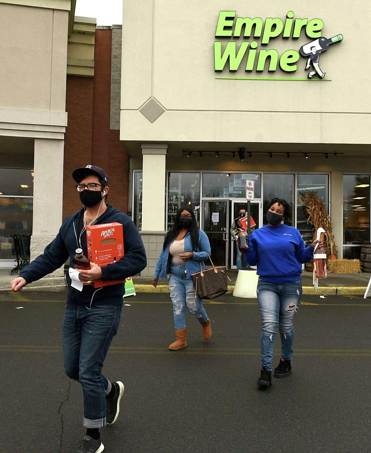 Customers leaving Empire Wine in Albany, N.Y. (Lori Van Buren/Times Union)