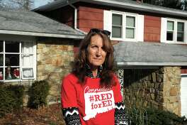 Andrea Norem, a high school English teacher, poses in front of her home in New Milford, Conn. Dec. 30, 2020.