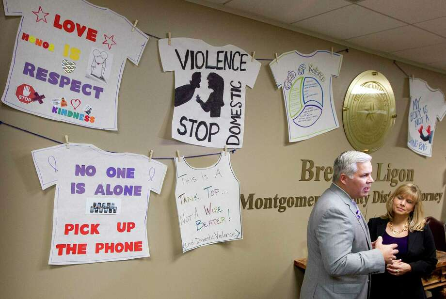 Montgomery County District Attorney Brett Ligon, left, talks about domestic violence challenges in the county as Sarah Raleigh, president & CEO of Montgomery County Women's Center, looks on at the Lee. G. Alworth building Friday, Oct. 7, 2016, in Conroe. Photo: Jason Fochtman, Staff / Houston Chronicle