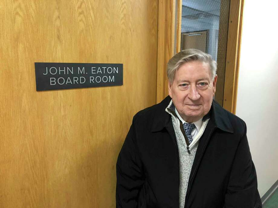 Eaton, founding president of WCC stands outside the door of the boardroom named in his honor. Eaton died Dec. 23. (Submitted photo)