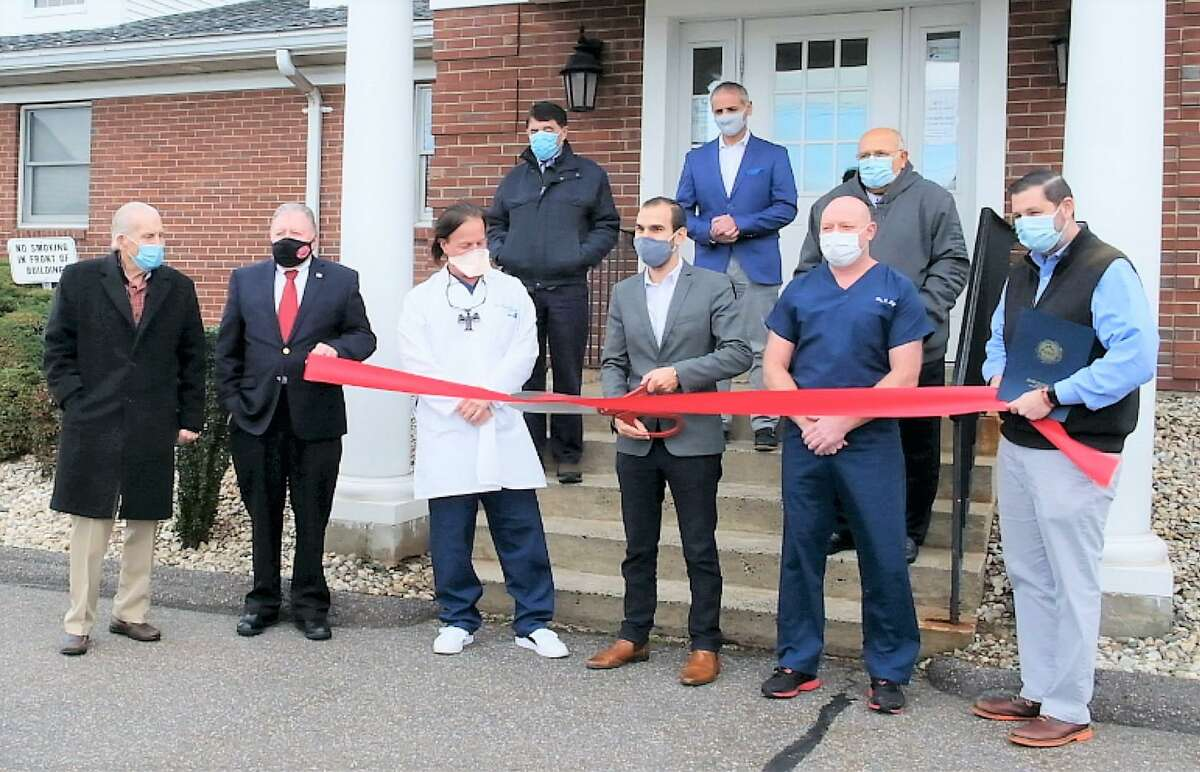 Dental Arts of Cromwell celebrated its newly renovated space with a ribbon-cutting Dec. 8. From left are Middlesex County Chamber of Commerce President Larry McHugh, past chamber chairman and owner of Willowbrook Spirit Shop Jay Polke, Dr. David Ridolfi, Town Planner Stuart Popper, Dental Arts CEO Adam Richichi, Demayo Properties owner George Flevotomos, Town Manager Tony Salvatore, Dr. Eben Light and Mayor Enzo Faienza.